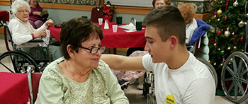 PAX exchange student from Ukraine visiting with a friend at a senior center