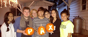 Exchange Students holding carved pumpkins