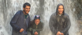 Exchange students stand under Utah waterfall.