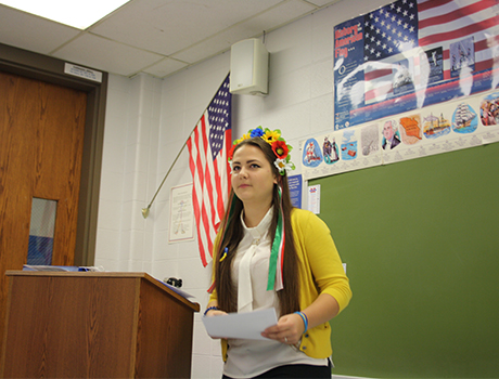 Ukrainian FLEX student wearing a traditional headpiece for a presentation during International Education Week in Wisconsin