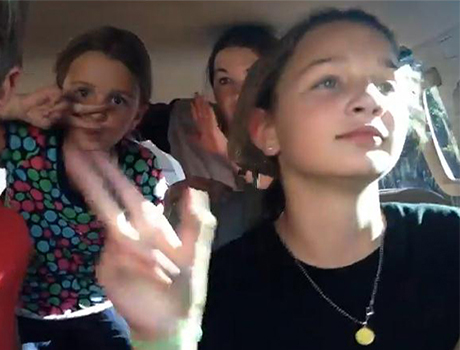 Future Leaders Exchange Program participant goofs around in the car with her host sisters and brother from New Mexico