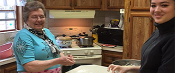 PAX exchange student from Mexico making rolls with her host grandmother in Michigan
