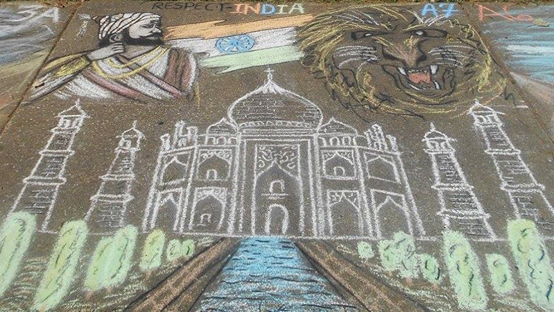 YES student from India presents his chalk art depicting his home country at a drawing competition in Illinois