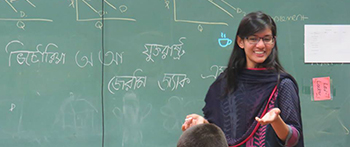 YES international exchange student in traditional dress teaches Bengali to her American classmates in New York