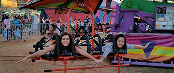 Spanish exchange student and her double placement from Egypt on an amusement ride at a county fair in Georgia