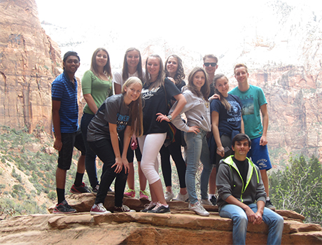 PAX international students from Utah and Nevada take a break from hiking during an enhancement trip in Zion National Park