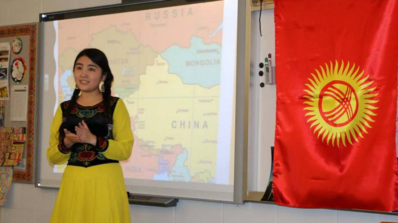 Future Leaders Exchange Program participant presenting about Kyrgyz culture at her West Virginia high school during IEW