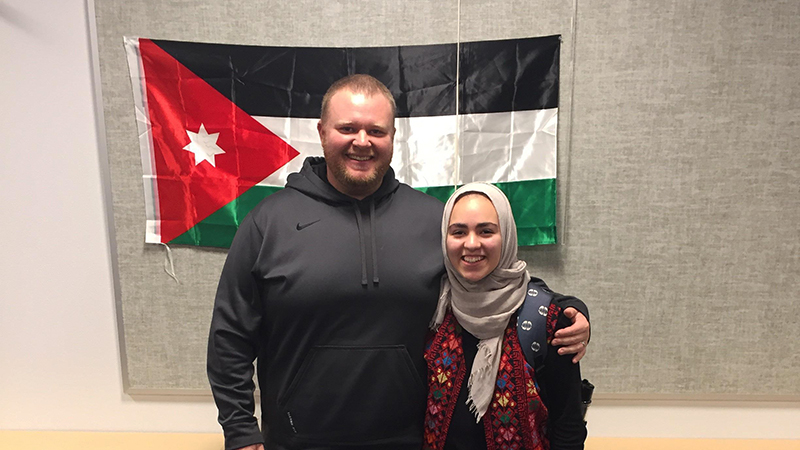 YES international student with her teacher after a presentation about Jordan culture during International Education Week