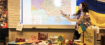 Ukrainian exchange student presents a historical map of the USSR during International Education Week in Indiana