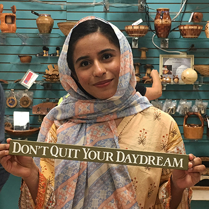 "Kennedy-Lugar Youth Exchange and Study YES Program student from Pakistan holding ""Don't quit your daydream"" sign"