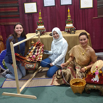Exchange students at Thai culture stand