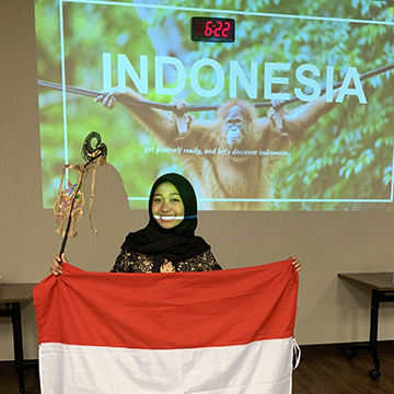 Indonesian exchange student with Indonesian flag classroom presentation