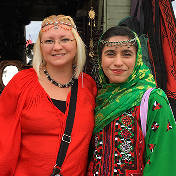 Exchange student Tilyan from Pakistan poses with her host mother