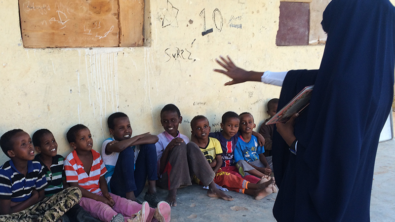PAX student from the Abaarso School teaches young children English as a volunteer at an orphanage in Somaliland