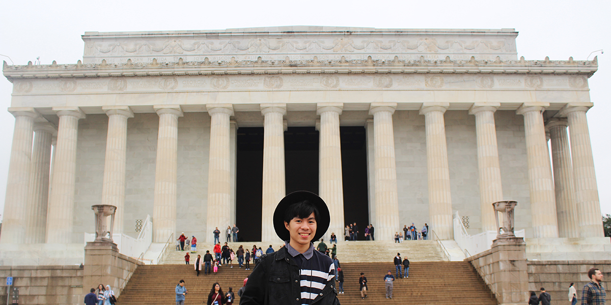 Amir poses in front of the Lincoln Memorial.