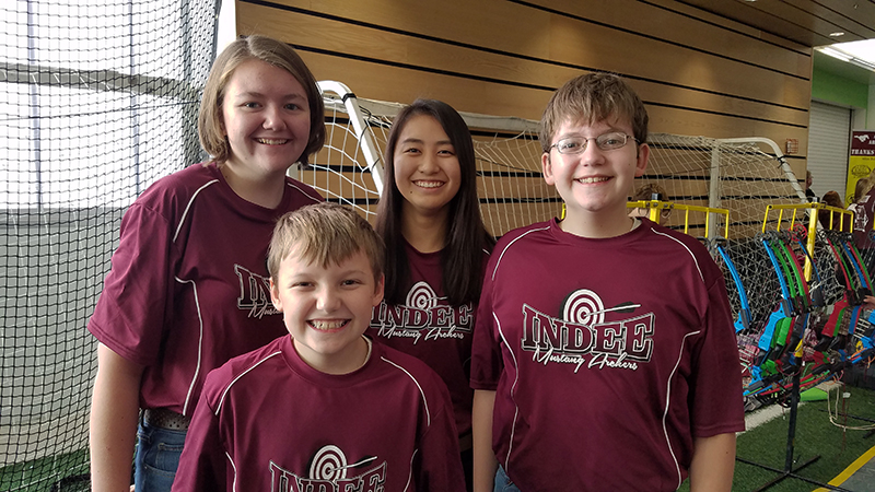 Japanese PAX student and her host siblings from Iowa dressed in their archery t-shirts