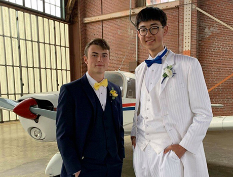 PAX exchange student from China with his host brother in front of an airplane in Arkansas