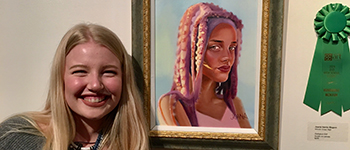 PAX exchange student from Spain with her award-winning painting in her host state Utah