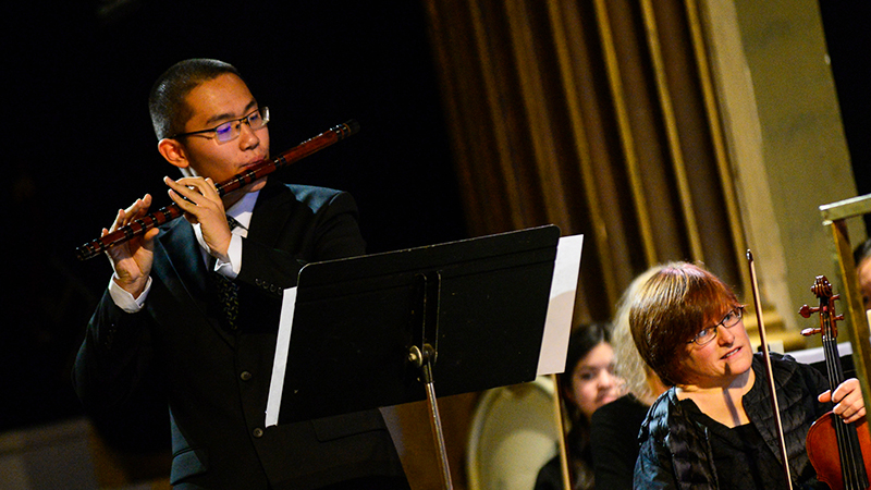 PAX student from China playing his bamboo flute in a concert with the Windham Orchestra in Vermont