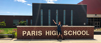 Ukrainian FLEX student enjoying a sunny day in front of his Illinois high school