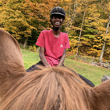 Exchange Student from Somaliland on a Horse 360x360
