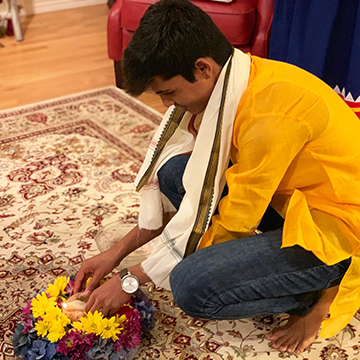 Teenage boy from India arranges flowers for holiday with U.S. host family