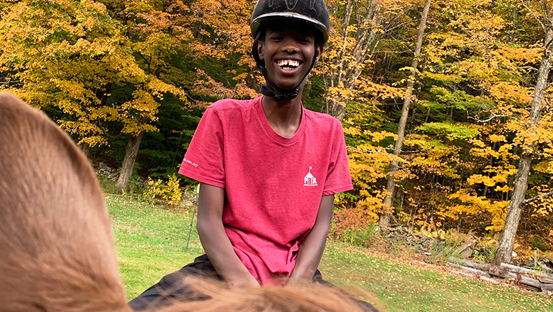 Abaarso School of Science and Technology student rides a horse for the first time