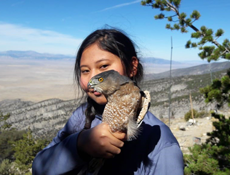 FLEX international student from Kazakhstan holds a hawk during a field trip in Utah