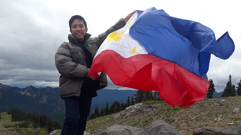 YES student from the Philippines enjoying the scenery on a trip through the mountains in Washington State