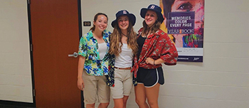 Exchange student from Spain and her American friends dressed as tourists for homecoming week