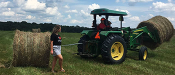 FLEX program participant from Ukraine learns about farming with her Mississippi host family