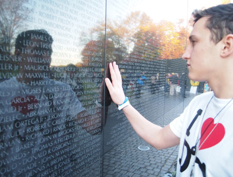 FLEX exchange student from Moldova reflects at the Vietnam Veterans Memorial during a trip to Washington, D.C.