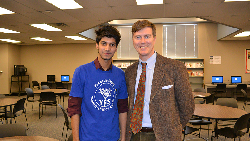 YES exchange student with his principal after a presentation about his home country during International Education Week