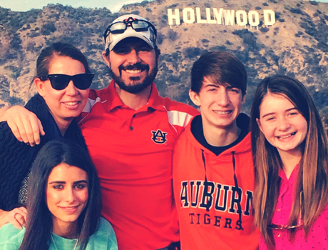 Spanish exchange student with her Alabama host family in front of the Hollywood sign during a family trip
