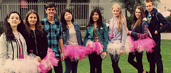 PAX exchange students wearing self-made tutus on a trip to San Diego to help at the Avon Breast Cancer Walk
