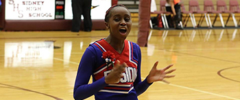 YES exchange student from Tanzania performing in her cheerleading uniform at her Montana high school