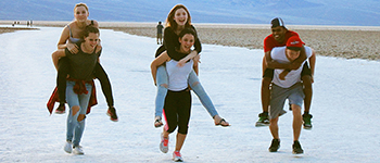 PAX international exchange students from Spain, Germany, Czech Republic, and Malaysia running a piggy back race in Nevada