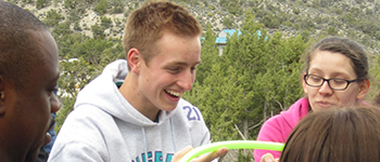 German exchange student laughing during a team-building exercise at a leadership training retreat in Nevada
