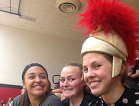 FLEX exchange student from Ukraine with her American friends sporting the school mascot Trojan hat