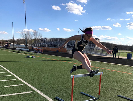 Future Leaders Exchange Program participant from Montenegro jumps a hurdle at school in Kansas