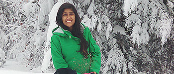 YES international exchange student from Pakistan with a snowman in New Hampshire