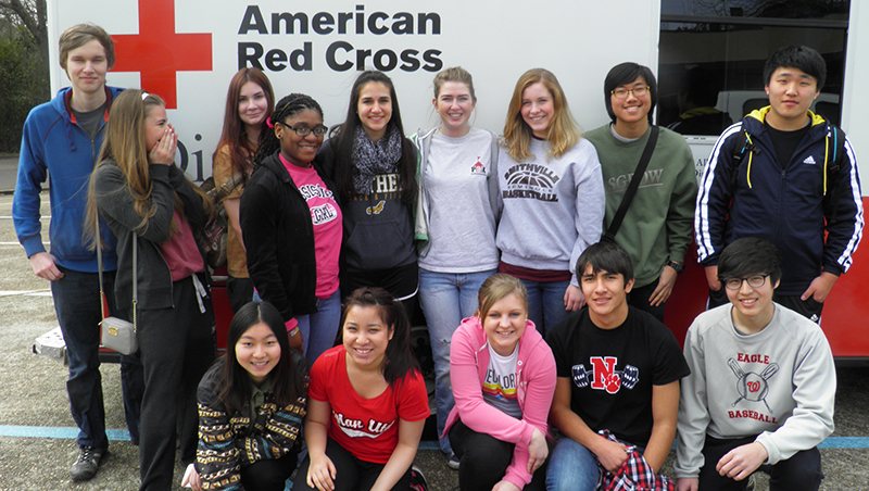 High school exchange students from around the world volunteering for the American Red Cross in Mississippi