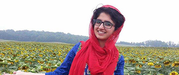 YES high school exchange student from Pakistan in front of a sunflower field in Pennsylvania