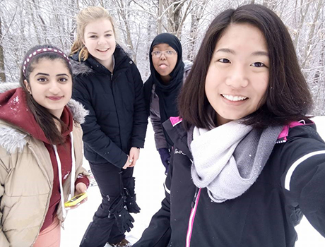 International high school students from Thailand, Somaliland, Palestine, and Germany in the snow in Massachusetts