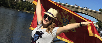 FLEX student from Montenegro waving her flag during a trip to Grand Rapids, Michigan