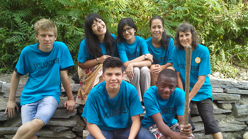 A group of PAX exchange students and their Vermont community coordinator after a day of volunteering
