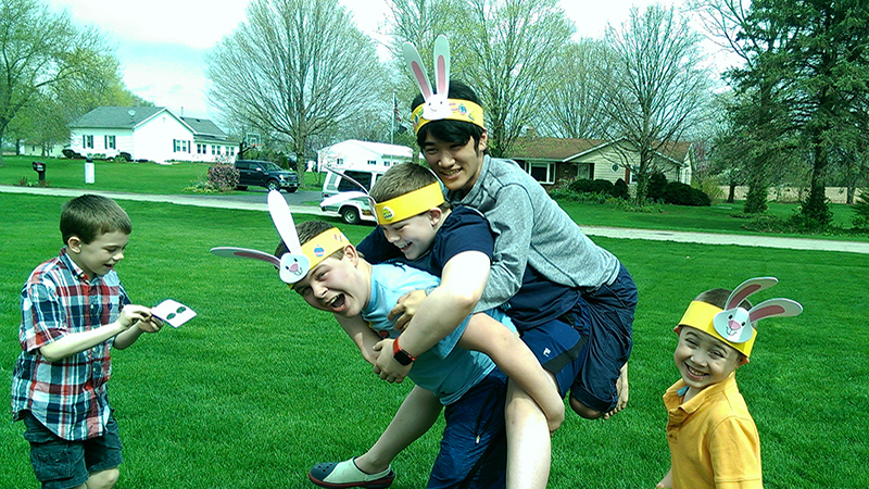 Japanese exchange student playing with his younger American cousins on Easter