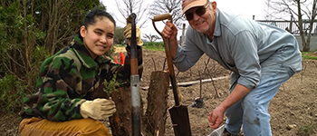 FLEX exchange student from Kyrgyzstan planting pine trees with her host grandpa in Ohio